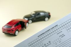 Compare car insurance concept. Car crash scene and car insurance document, compare car insurance concept. yellow background royalty free stock photography