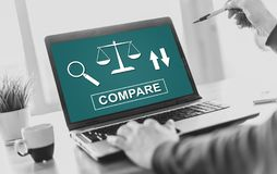 Compare concept on a laptop screen. Laptop screen displaying a compare concept royalty free stock photos