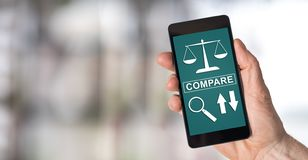 Compare concept on a smartphone. Smartphone screen displaying a compare concept stock photography