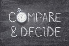 Compare and decide. Phrase written on chalkboard with vintage precise stopwatch stock photos