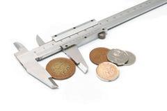 Compare los precios - calibrador y dinero Imágenes de archivo libres de regalías