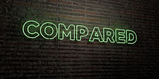 COMPARED -Realistic Neon Sign on Brick Wall background - 3D rendered royalty free stock image Royalty Free Stock Image