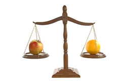 Comparing Apples and Oranges Revised Stock Photo