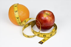 Comparing Apples to Oranges Royalty Free Stock Photos