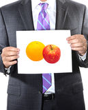 Comparing apples to oranges Royalty Free Stock Photography