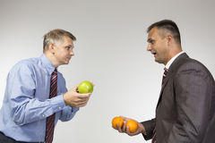 Comparing apples to oranges Stock Images