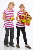 Comparing gifts. Two Girls compare their gifts Stock Image