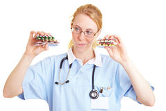 Comparing pills Stock Image