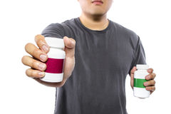 Comparing Supplement Brands Royalty Free Stock Photo