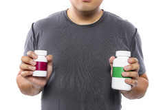 Comparing Supplement Brands Stock Photography