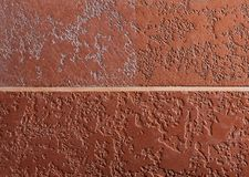 Comparing two types of brown plaster textured background. Abstact brown stucco. Texture of plaster on the wall. Comparing two different types of brown plaster stock image