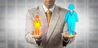 Comparing Two Female Workers Of Different Power. Unrecognizable manager contrasting a small female worker icon with a much taller one in the other hand. Concept Stock Photos