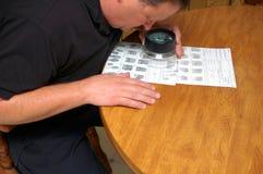 Comparision. Forensic investigator comparing fingerprints during a criminal investigation stock photography