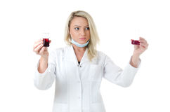 Comparison. Beauty lab worker holding and comparising two test tubes with red liquids Stock Photo