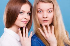 Comparison of girls with and without make up. Look results of using cosmetics. Portrait of two girls one with and second without make up. Comparison of natural Royalty Free Stock Image