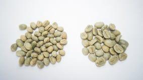 Peaberry vs regular coffee stock image
