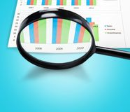 Comparison. Magnifying glass research finance chart business examining stock images