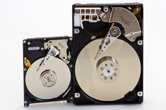 Comparison of the size of 2.5 and 3.5 disk drive Stock Photography