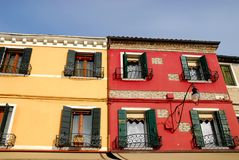 A comparison of two houses in Burano Venice area Italy. Photo taken on the island of Burano in the village of fishermen and lace embroiderers in the municipality Royalty Free Stock Photography