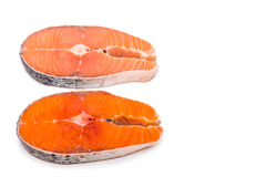 Comparison between wild and farmed salmon blocks on white backgr Stock Photo