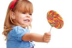 Compartilhando de dar afastado o lollipop Fotografia de Stock