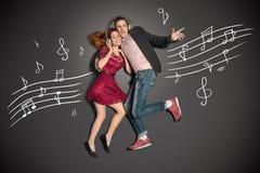 Compartilhando de fones de ouvido Imagens de Stock Royalty Free
