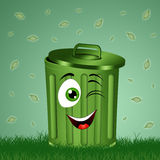 Compartimiento de basura divertido en la hierba Imagenes de archivo