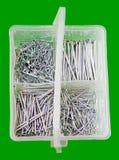Compartimiento plástico blanco de clavos Foto de archivo libre de regalías