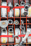 Compartment of rolled up fire hoses on fire truck Stock Images