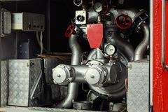 Compartment of rolled up fire hoses on a fireengine. Emergency s Stock Images