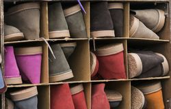 Footwear ordered by numbering. Compartments created to store footwear separated by numbering Stock Images