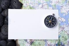 Compas avec la roche Photographie stock