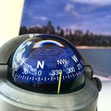 Compas. Boat compass, north west. Beach from the sea royalty free stock photos