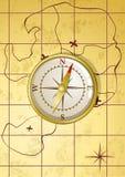 Compas d'or de vecteur sur la vieille carte Image stock