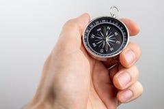 Compas dans la main images stock