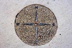 Compas dans le trottoir Photos libres de droits
