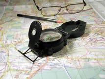 Compas e mapa. Fotos de Stock