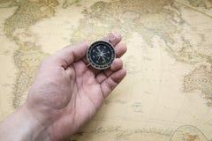 Compas et carte Photos stock