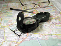 Compas and map. Defining on map command Stock Photos