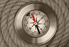 Compass на предпосылке веревочек корабля Стоковые Изображения