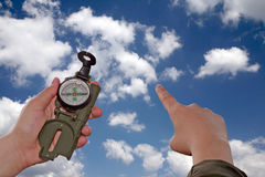 Compass. In the hand with the clouds background Stock Photography