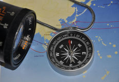 Compass. Mariners compass with view finder placed on world map Royalty Free Stock Photography