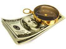 Compass. Gold compass on the money on white background Royalty Free Stock Image