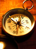 Compass. An old pocket compass on wood Royalty Free Stock Image
