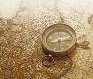 Compass. A compass lies on an age-old map Royalty Free Stock Image
