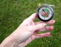 Compass. Plastic compass in a hand Stock Photos