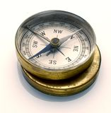 Compass. Antique brass compass on white Royalty Free Stock Photography