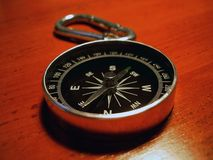 Compass. On a wooden table showing SW Royalty Free Stock Photos