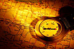 Compass. And a Map With Creative Lighting Stock Photos