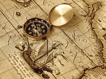 Compass. A compass lies on an age-old map Royalty Free Stock Photography